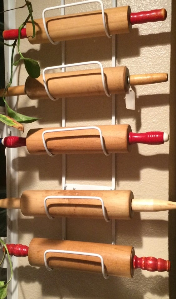 rolling pins on a wine rack