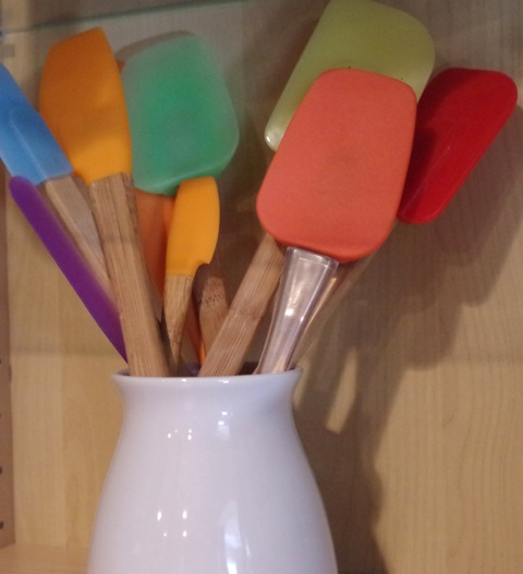 bright colored spatulas as kitchen decor
