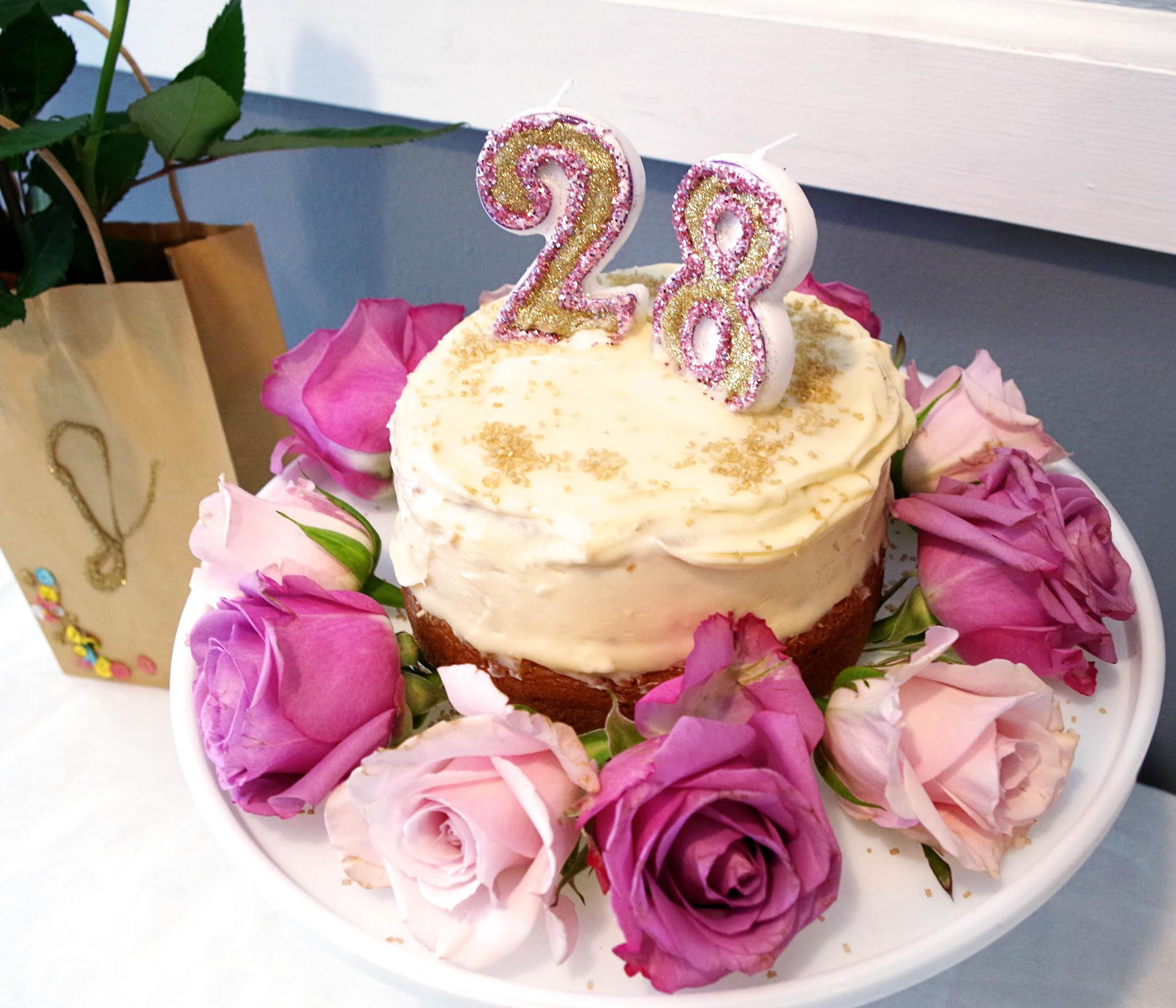 cake with roses, candles and frosting