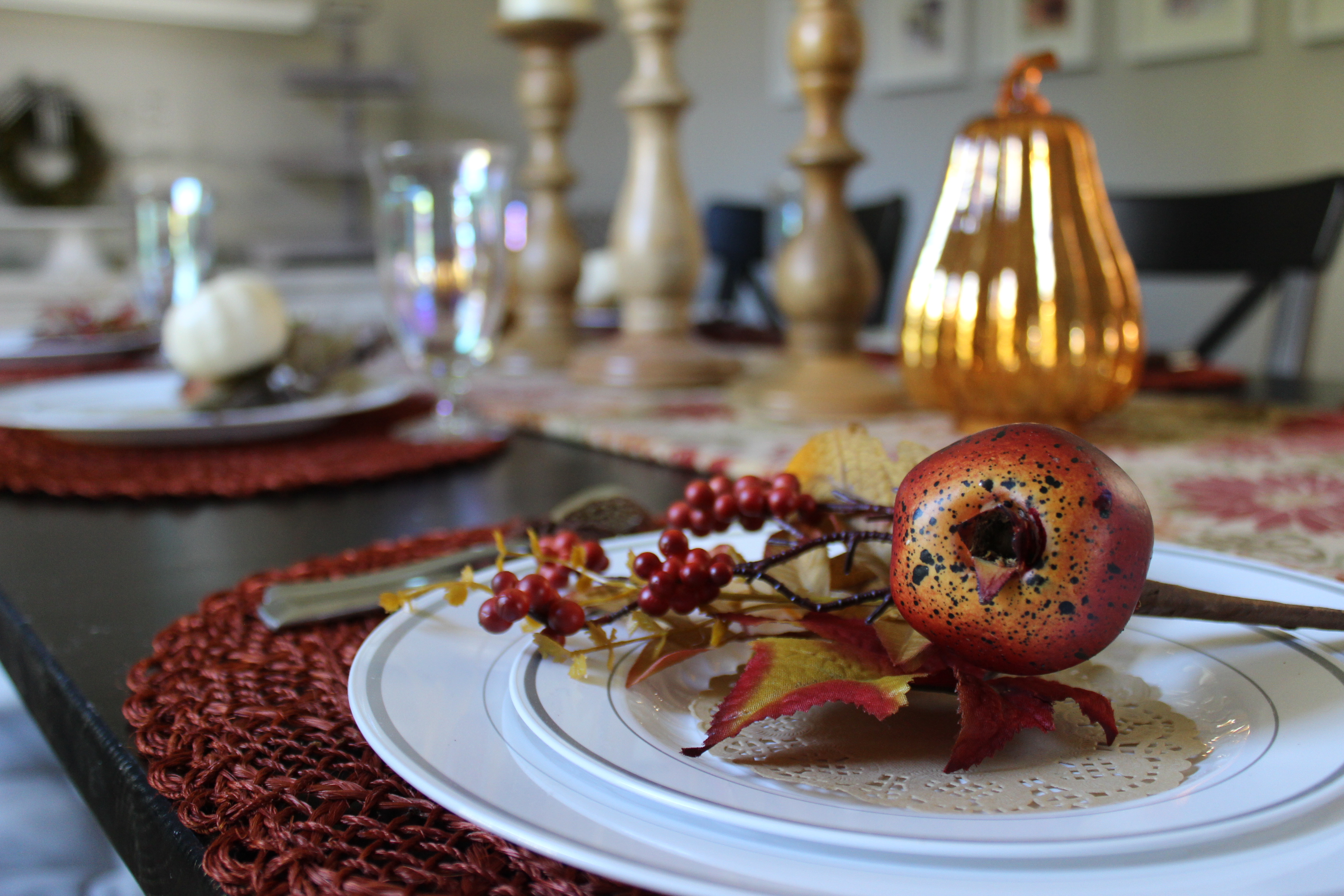 Use deep reds and other fall colors for your Thanksgiving table decore