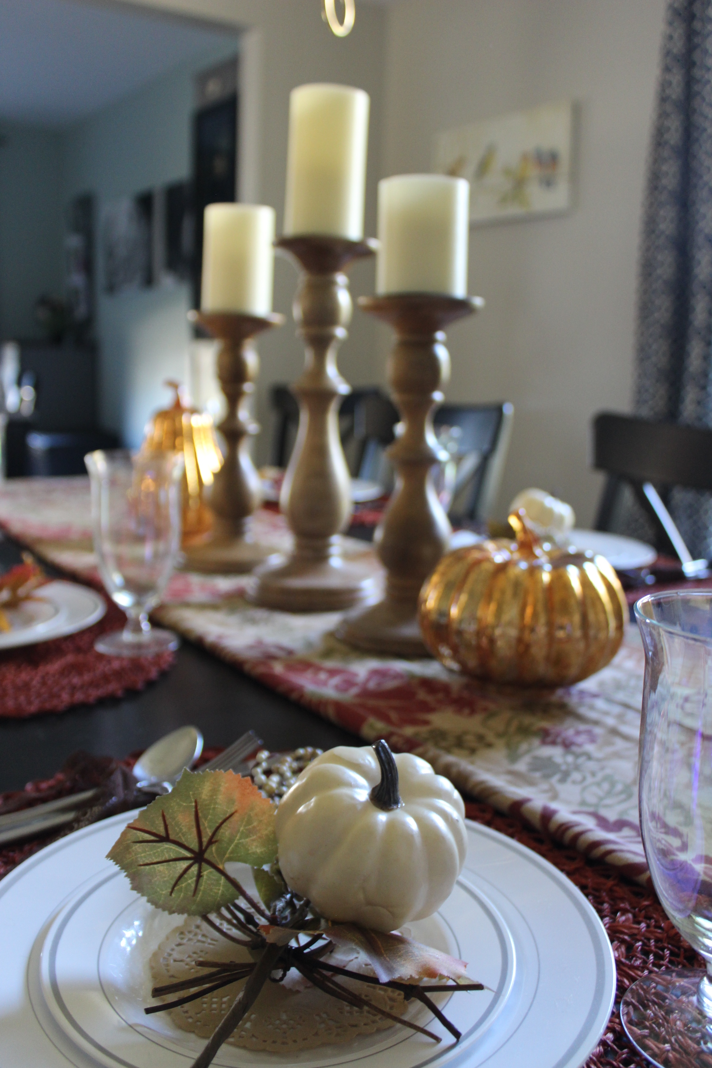 Tall candlesticks for your Thanksgiving centerpiece allow people to converse across the table.