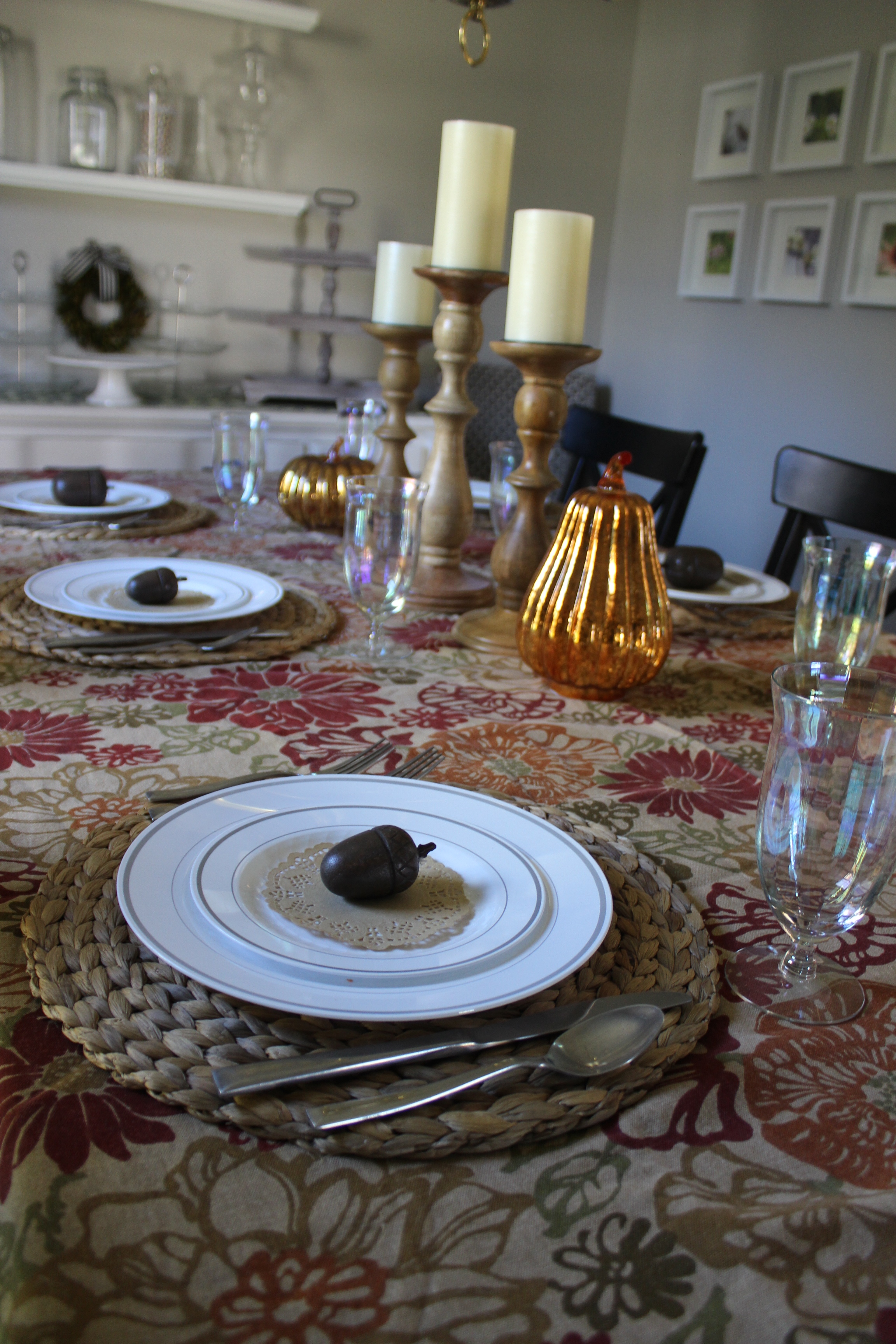 A cheery fall table cloth adds charm to your Thanksgiving table decor