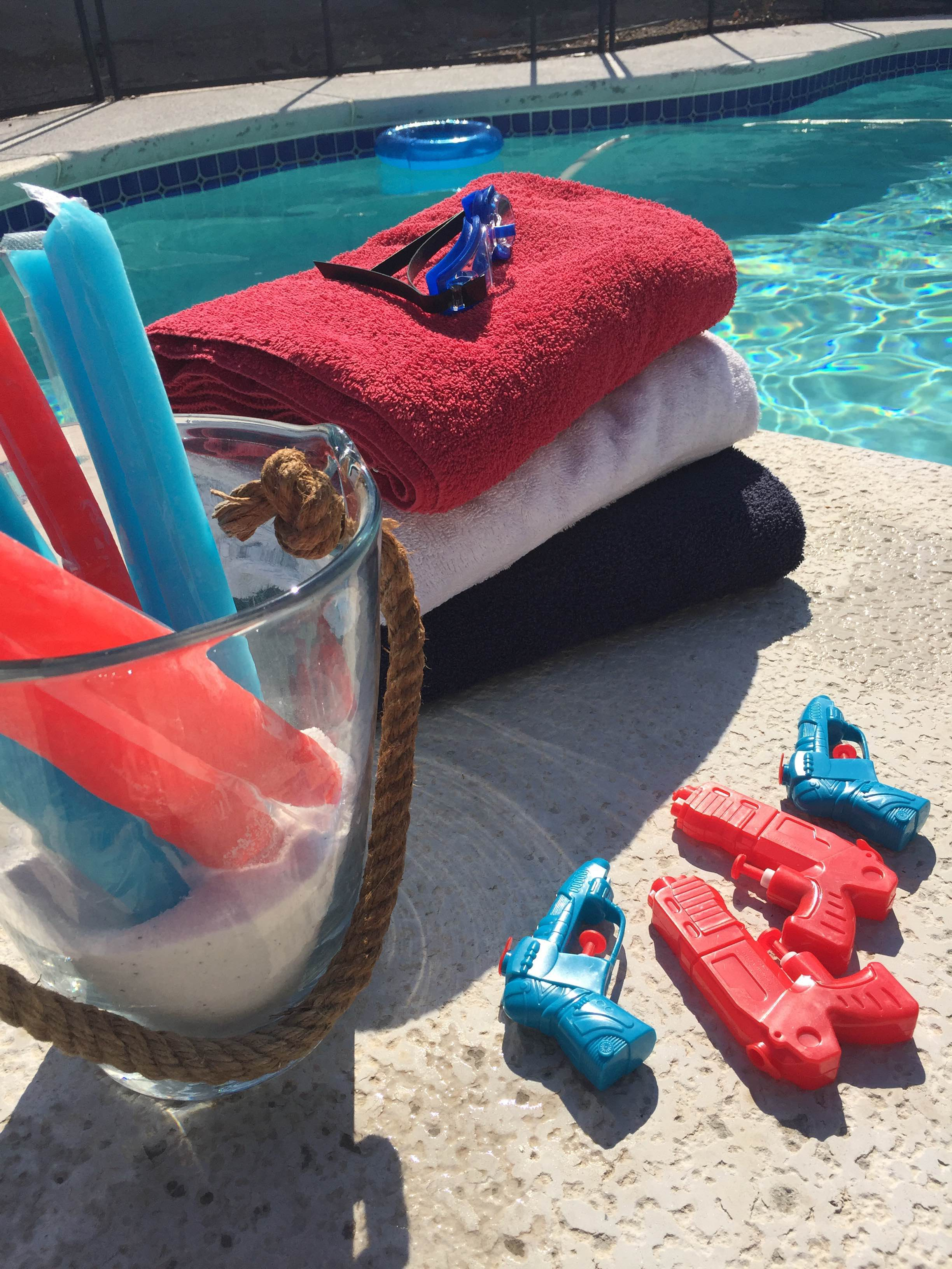 Popsicles and red, white and blue towels pool side.