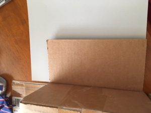 Picture of a trick to get the perfectly sized piece of paper to cover cardboard