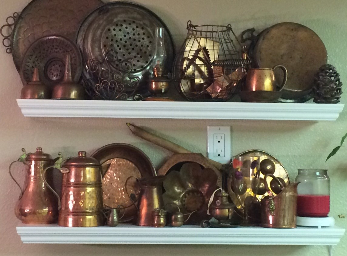 a collection of copper on shelves