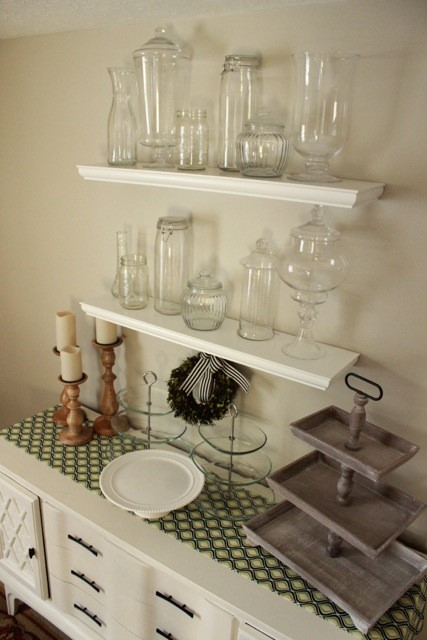 a collection of glasses on shelves