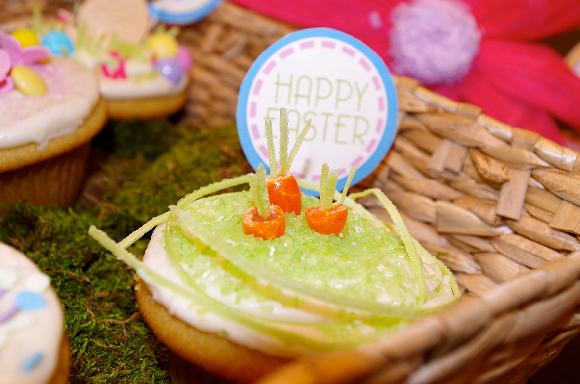Super moist cupcake with a carrot decorated into the top