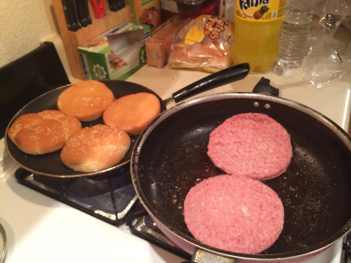 cooking burgers and toasting buns