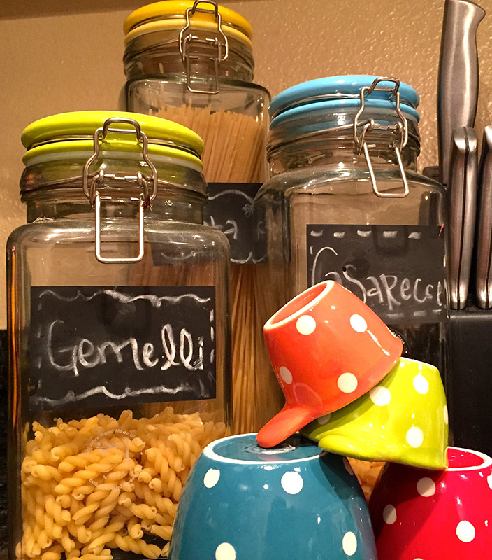 colored jars and measuring cups