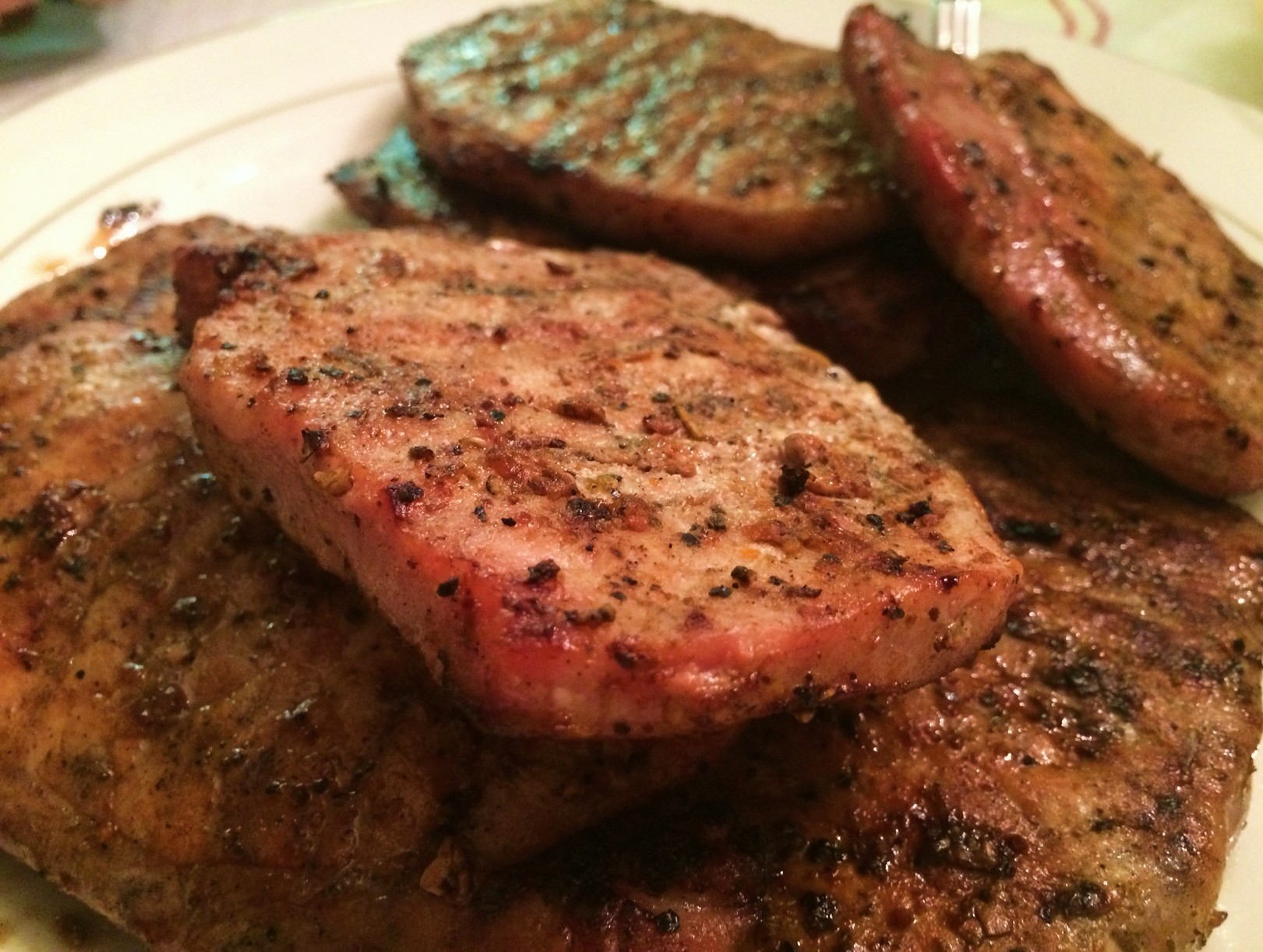 Perfectly Grilled pork chops on a serving dish
