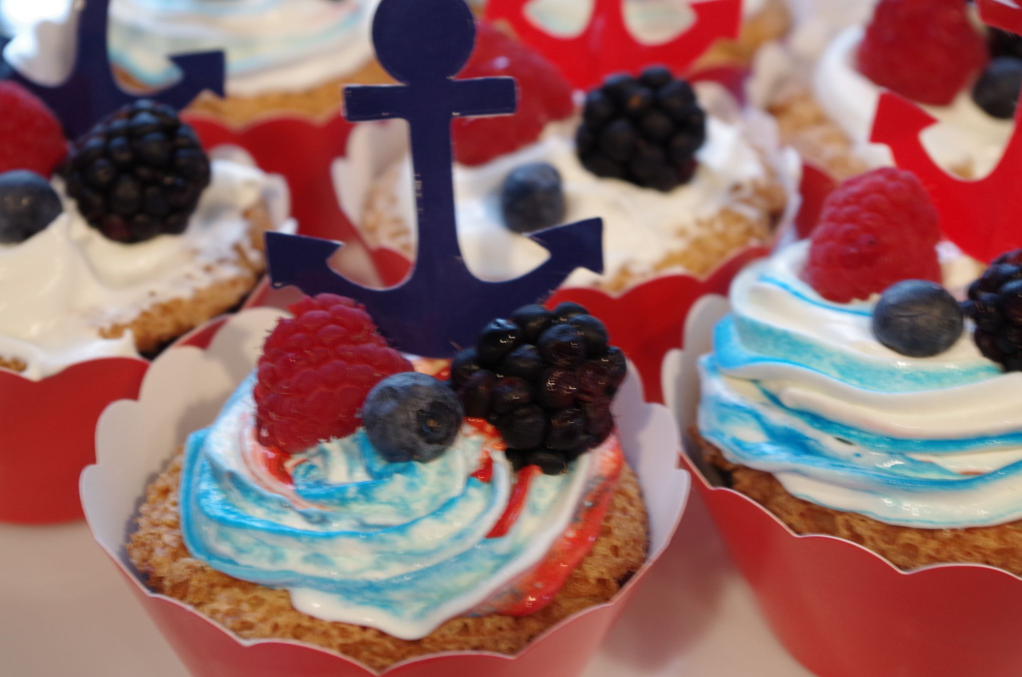 Fourth of July cupcakes with red white and blue cool whip