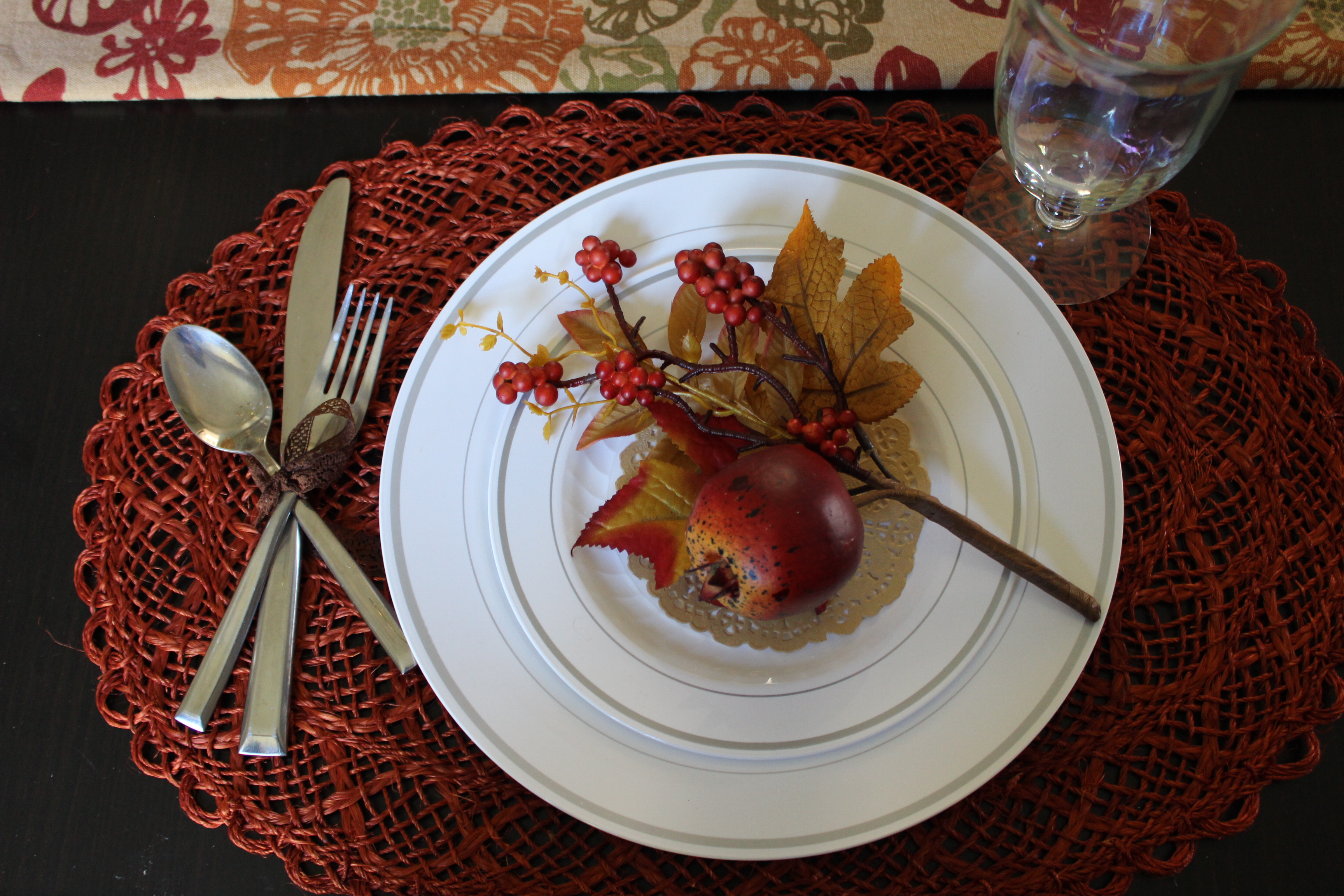 Fall sprigs from the craft store add beauty and funtionality to your Thanksgiving table setting. Use them to hold a place card.