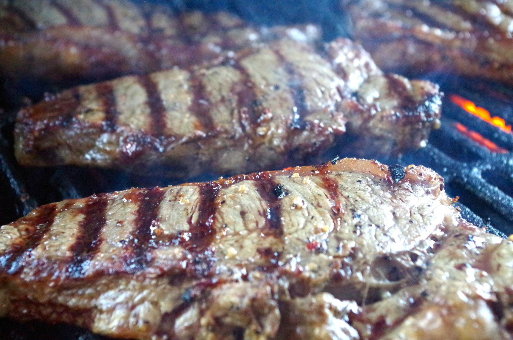 steaks with grill marks on the grill