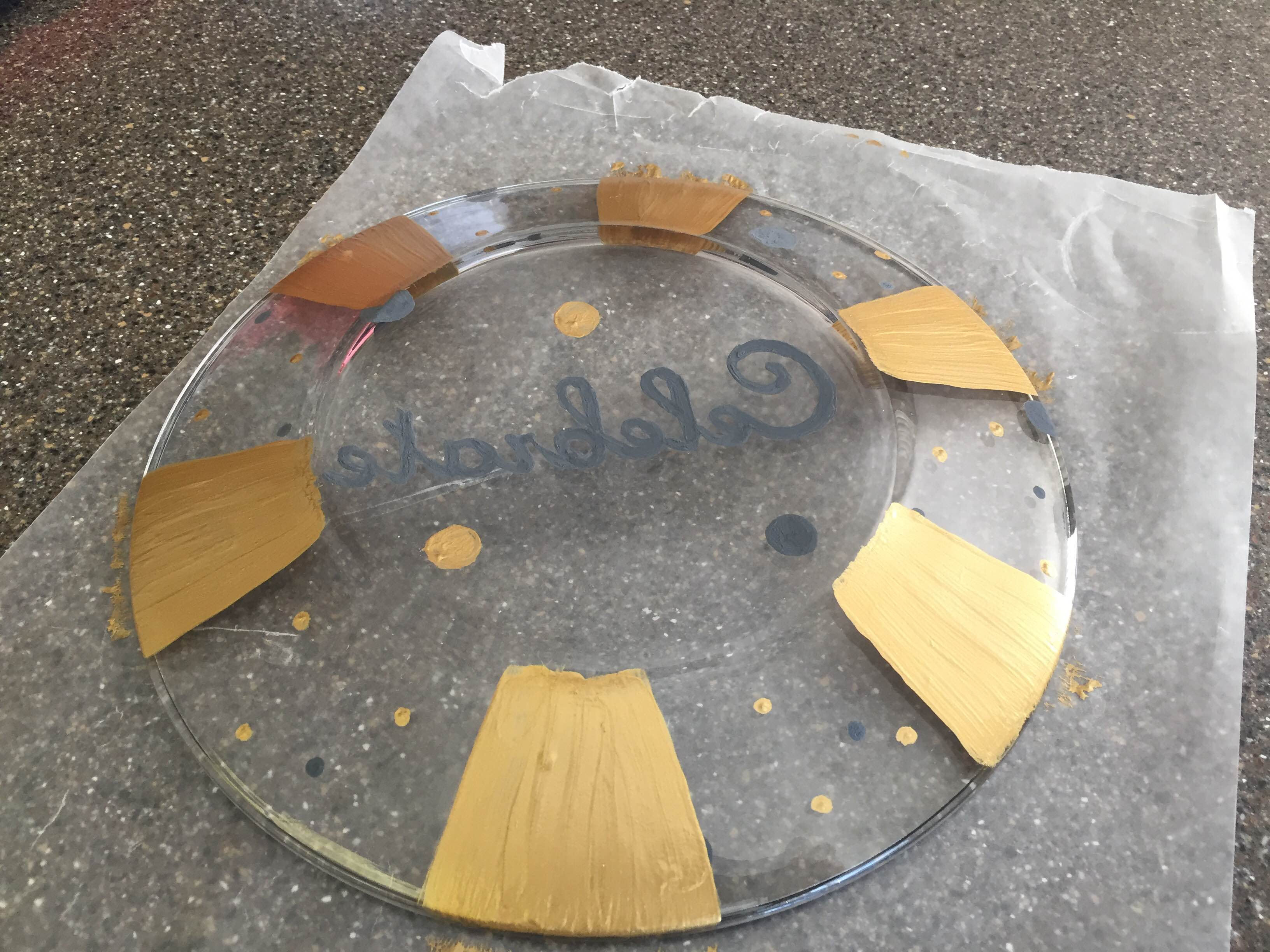 Glass plate painted gold