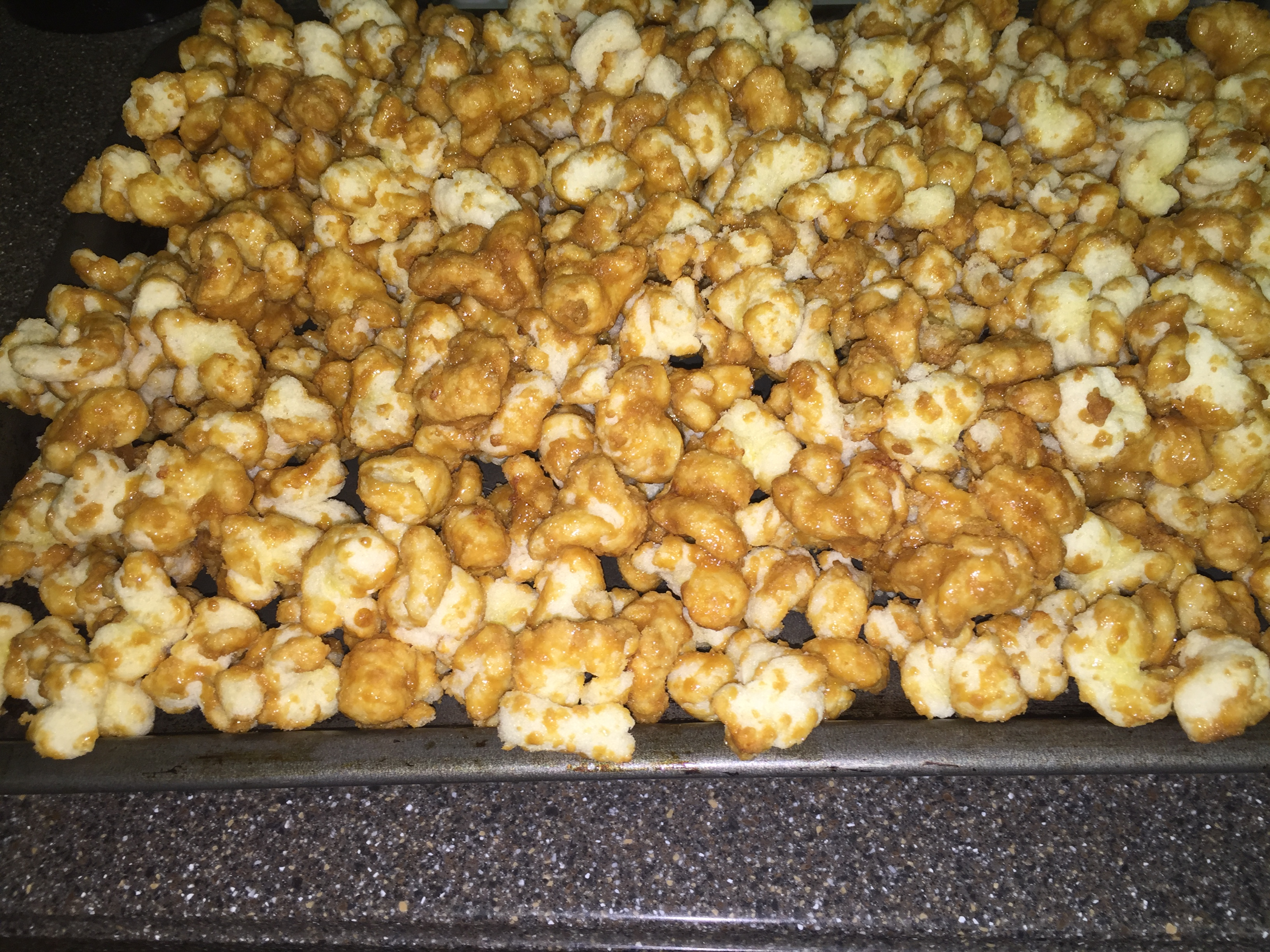 Caramel Puff Corn Recipe cooling on a cookie sheet